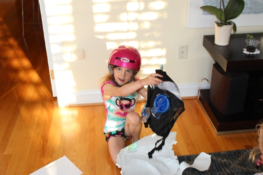 After being instructed to put on her helmet, Olive was lead to this gift - her own camelbak...mmm...wonder what the big present might be?