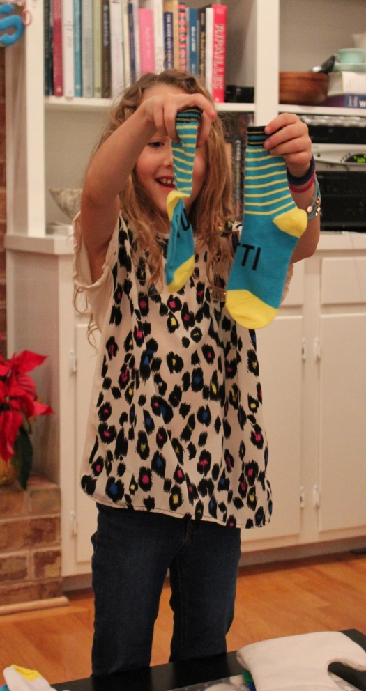 Little Miss Matched socks! They spell out ATTITUDE!