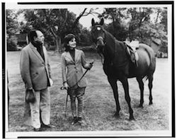 Mrs Kennedy shows the King of Pakistan her horse.