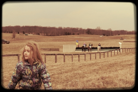 Edie checks out the course while the riders in the first race check out the first jump.