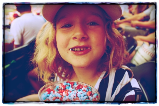 Edie indulging in some ice cream dippin' dots. Other important baseball snacks are peanuts and Crackerjack - kind of like caramel popcorn.