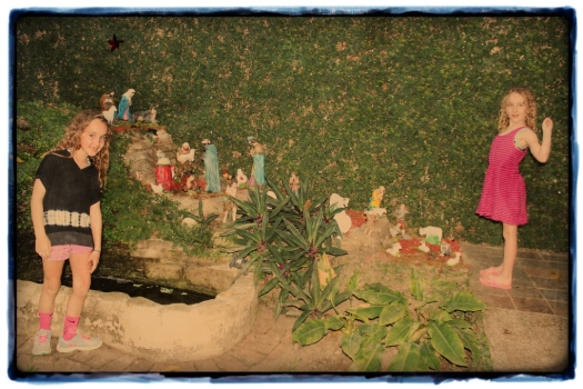 Oliva and Edie posing with one of the many and varied Nativity scenes we encountered during our trip.